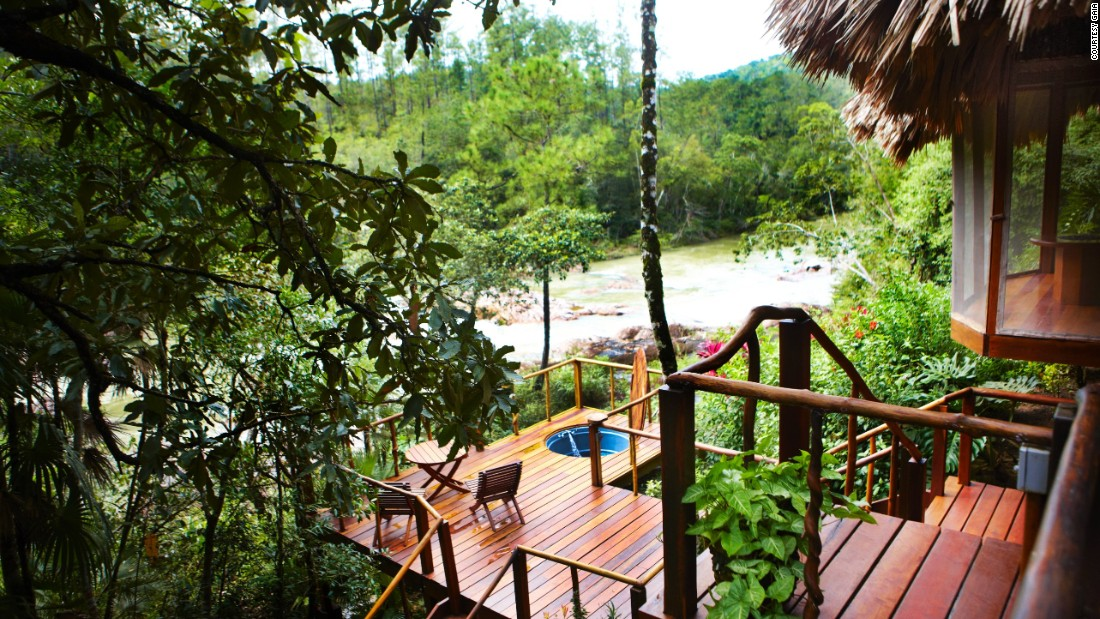 The jungles of Belize offer a welcome refuge from the pounding Caribbean sun. Ecotourism gem Gaïa Riverlodge peeks over a waterfall and a river that powers it.