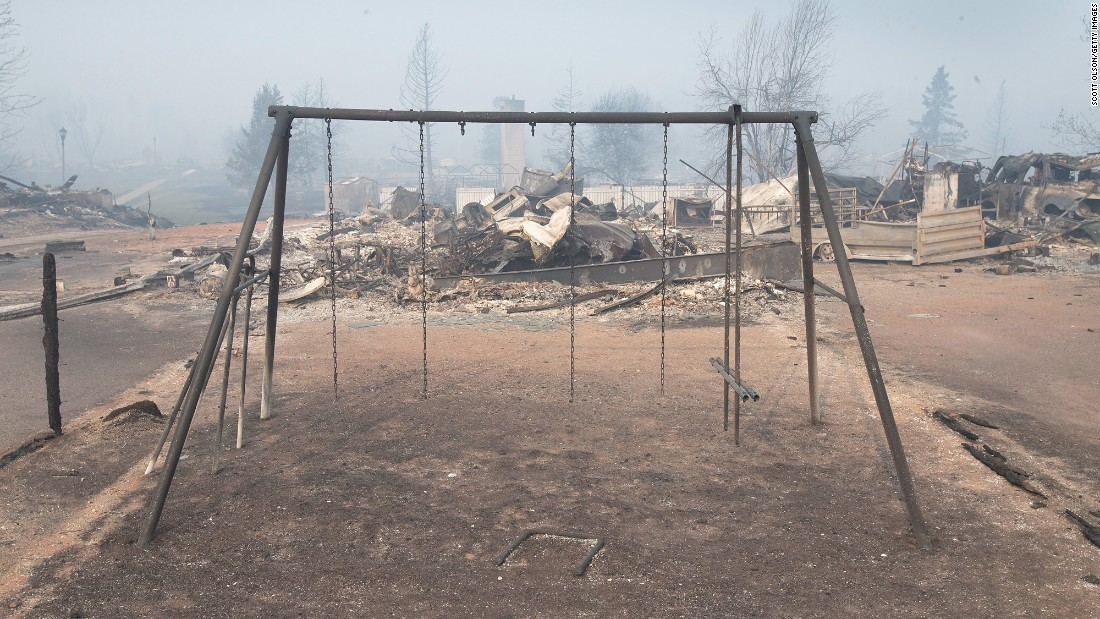The remains of a swing sits in a residential neighborhood destroyed by the fire on May 6 in Fort McMurray.