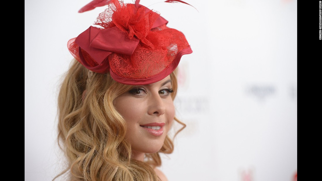 Figure skater Tara Lipinski shows off her striking red hat.