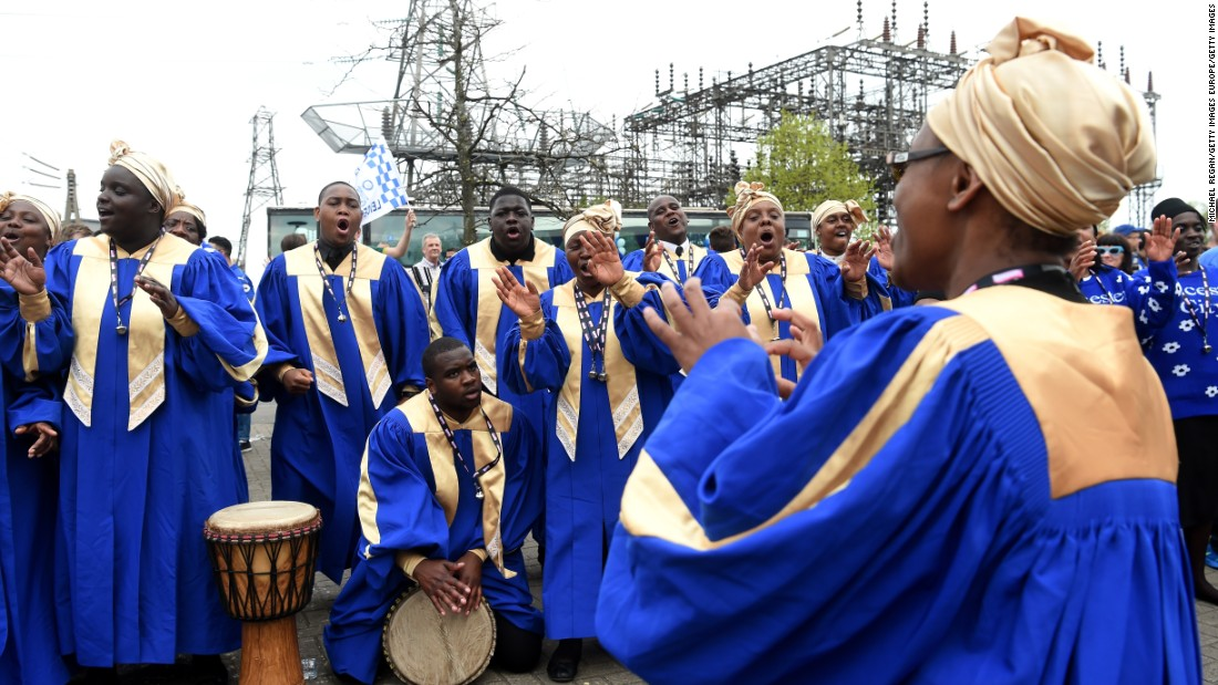 Members of a choir sing outside the King Power Stadium before the match.