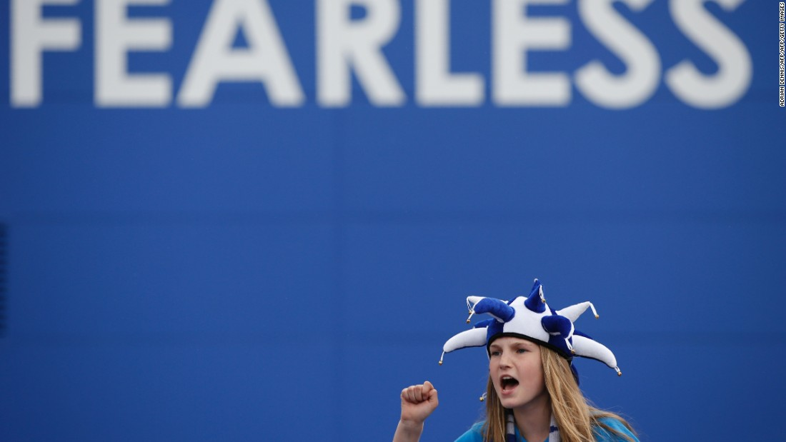 A Leicester fan sings before entering the King Power Stadium Saturday.
