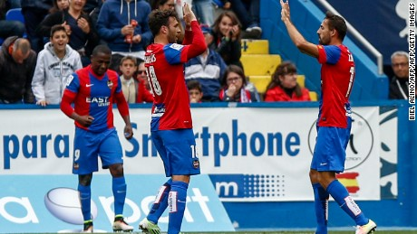 Levante's Victor Casadesus (center) celebrate after scoring against Atletico Madrid.
