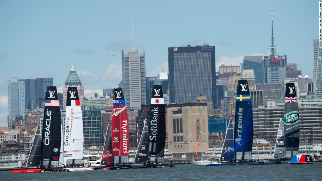 Sailboats maneuver for position during the start of the first race on Sunday.
