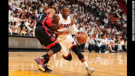 Miami Heat guard Dwyane Wade drives past Raptors forward DeMarre Carroll in Game 3 of their playoff series Saturday.