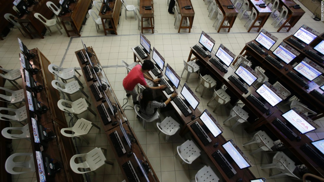 Workers check computers at the command center of the church-backed election watchdog Parish Pastoral Council for Responsible Voting (PPCRV) in Manila, Philippines on the eve of election day, Sunday, May 8, 2016.