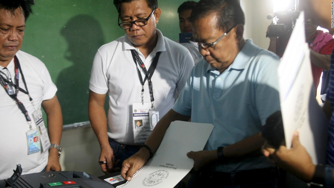 Presidential Candidate And Current Philippine Vice President Jejomar Binay Right Inserts His Ballot Into