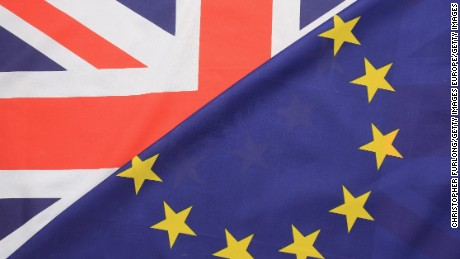 Britain's Union flag, known as the Union Jack, and the flag of the European Union.