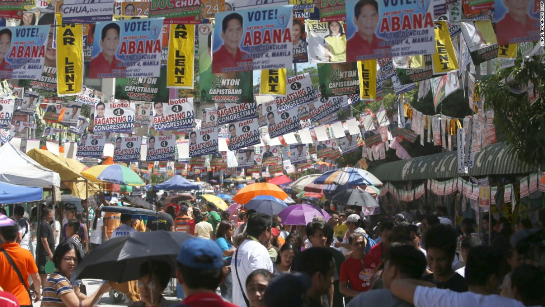 A street in suburban Manila, the capital of the Philippines, is covered in campaign posters. Polls opened nationwide on Monday, May 9, 2016.