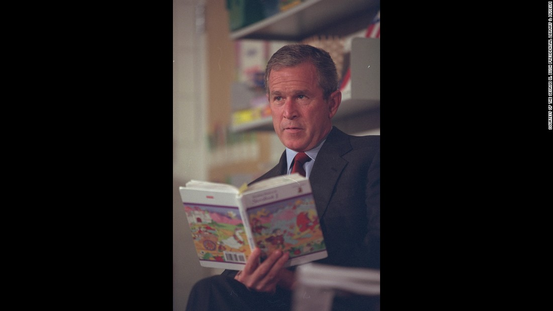 Bush listens to students read during the visit to Emma E. Booker Elementary School.