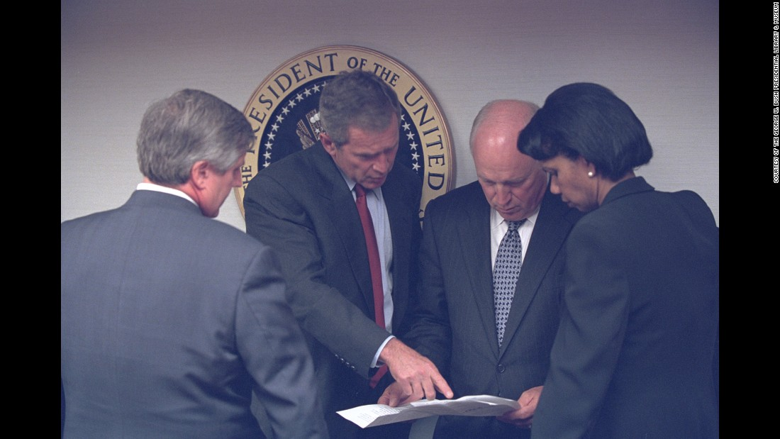 Bush talks with Card, Vice President Dick Cheney and National Security Advisor Condoleezza Rice in Washington.