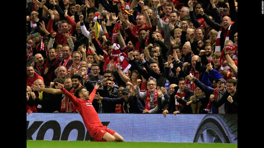 "Liverpool's Adam Lallana celebrates in front of his home fans after scoring a goal during the Europa League semifinal against Villarreal on Thursday, May 5. The English club won 3-0 to advance to the final against Sevilla. <a href=""http://edition.cnn.com/2016/05/05/football/liverpool-europa-league-villarreal-klopp/"">READ MORE: Liverpool overpowers Villarreal</a>"