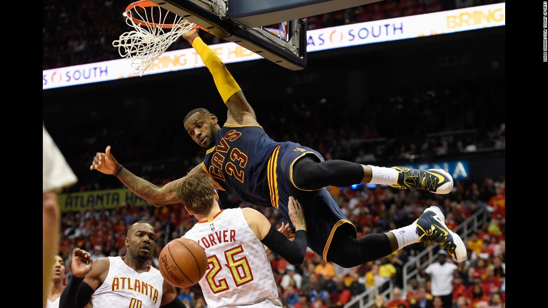 Cleveland's LeBron James dunks over Kyle Korver during an NBA playoff game in Atlanta on Friday, May 6. The Cavs swept the Hawks to advance to the Eastern Conference finals.