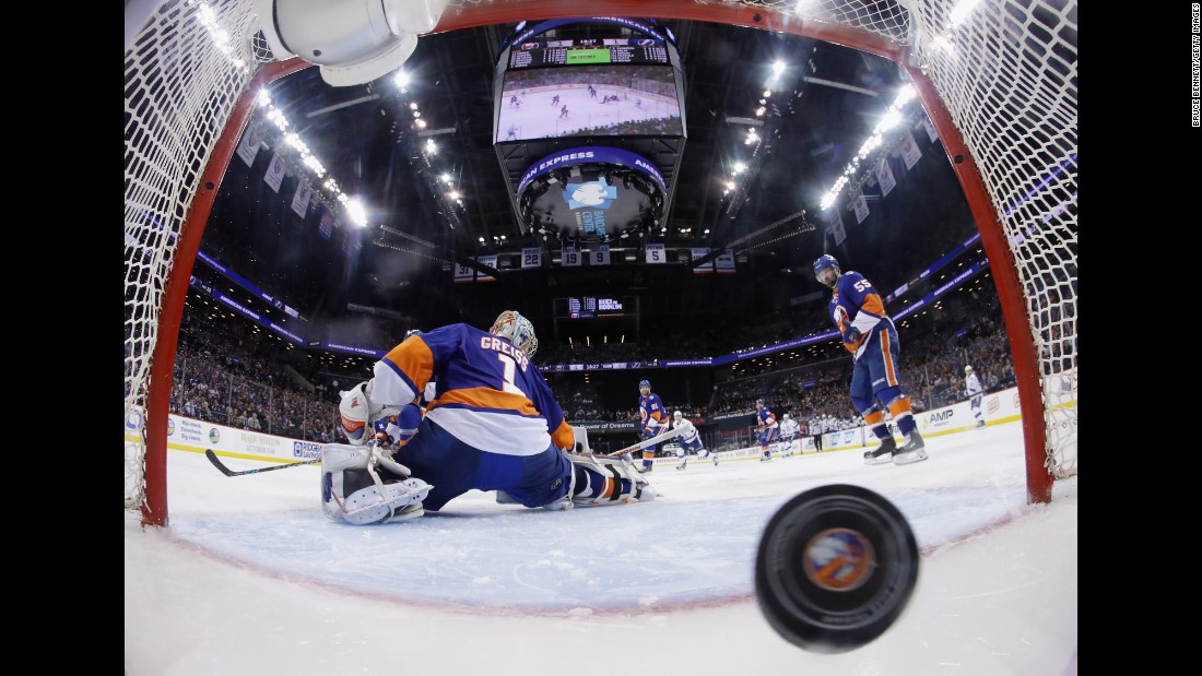 The puck gets behind New York Islanders goalie Thomas Greiss on Friday, May 6, giving the Tampa Bay Lightning an overtime victory in Game 4 of their NHL playoff series. Jason Garrison scored the game-winning goal, and the Lightning would go on to win the series in five games.