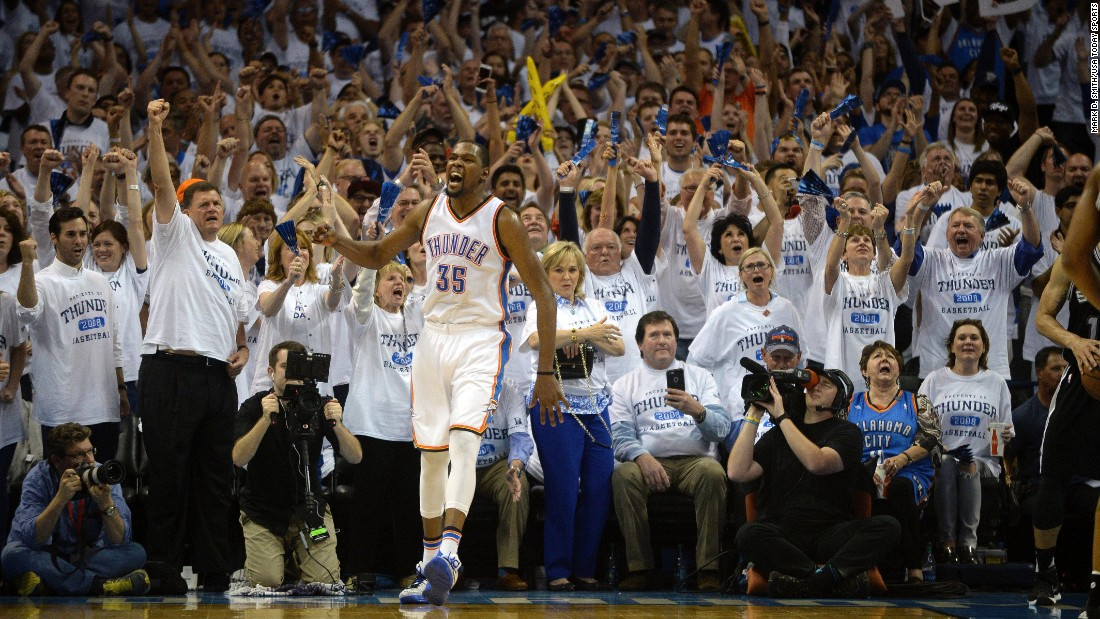Kevin Durant and Oklahoma City fans react during the fourth quarter of an NBA playoff game against San Antonio on Sunday, May 8. Durant scored 41 points in the game -- a personal playoff high -- as the Thunder tied the second-round series at two games apiece.
