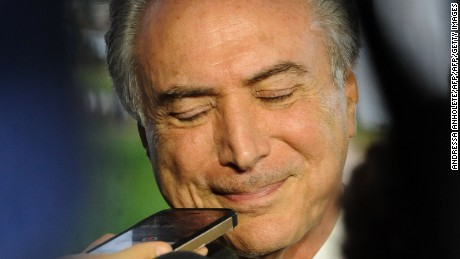 Brazil's vice President Michel Temer talks with the press in Brasilia, on April 11, 2016. Temer -- who would take over if Dilma Rousseff is impeached -- on Monday accidentally released the speech he'd give to the nation if she were forced to stand aside, reports said. / AFP / ANDRESSA ANHOLETE        (Photo credit should read ANDRESSA ANHOLETE/AFP/Getty Images)