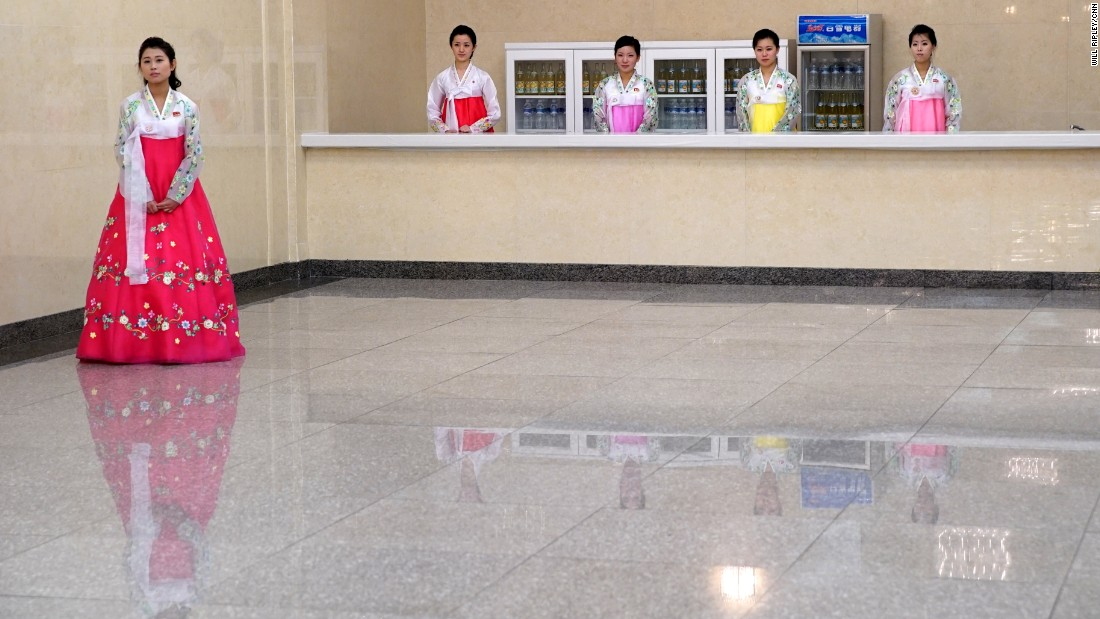 North Korean women in traditional dress prepare to greet delegates at the 7th Workers' Party Congress, held for the first time in 36 years.