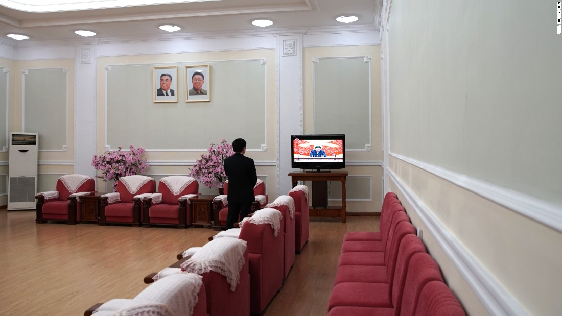 A man watches the 7th Workers' Party Congress in Pyongyang, where North Korean leader Kim Jong Un gave a 15-minute opening speech, touting the country's weapons development.
