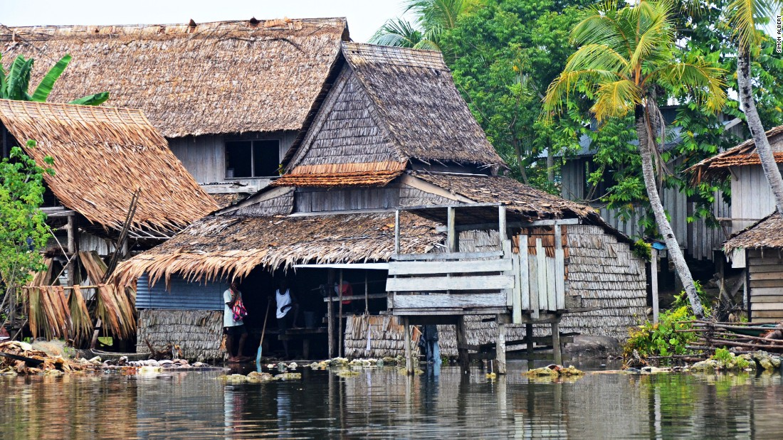 Communities in parts of the Solomon Islands have been forced to move to higher volcanic islands as they watch their coastline recede, pushing seawater into their homes. Photo taken October 2013.