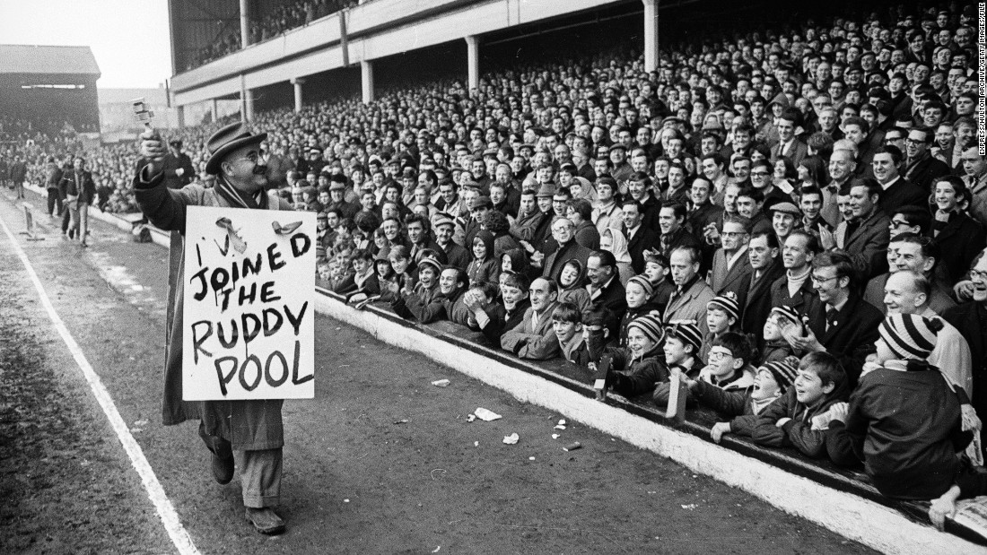 "Warren Mitchell, who played a bigoted cockney West Ham supporter in the TV series ""Till Death Us Do Part,"" is pictured at Upton Park in February 1968."