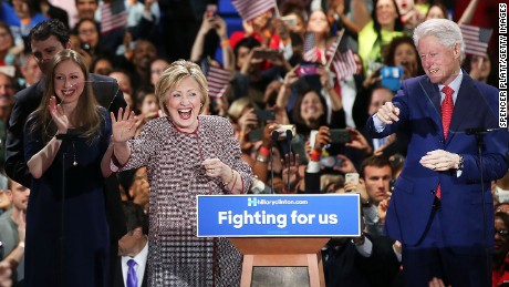 NEW YORK, NY - APRIL 19: Democratic presidential candidate Hillary Clinton walks on stage with her husband Bill Clinton, daughter Chelsea Clinton and son-in-law Marc Mezvinsky after winning the highly contested New York primary on April 19, 2016 in New York City. Clinton, who had enjoyed a large lead over her rival Bernie Sanders only months ago, saw that lead shrink as the Sanders campaign made inroads with younger and more liberal voters. (Photo by Spencer Platt/Getty Images)