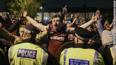 West Ham fans celebrate Tuesday's win over Manchester United outside the Boleyn Ground.