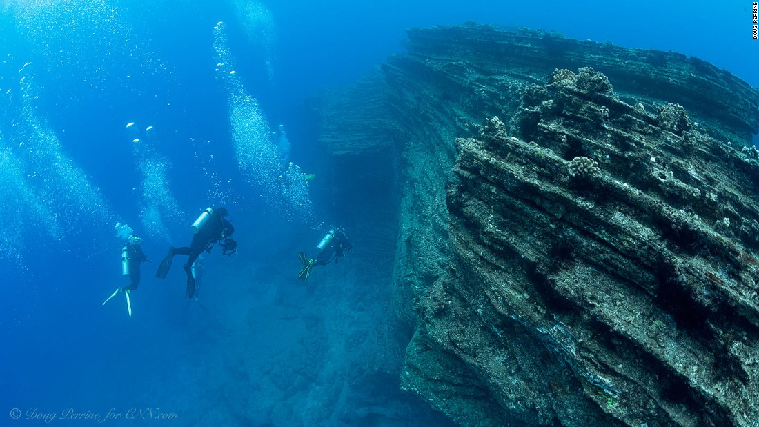 The underwater seascape has vertical walls and spires that plunge precipitously to depths of hundreds of feet.