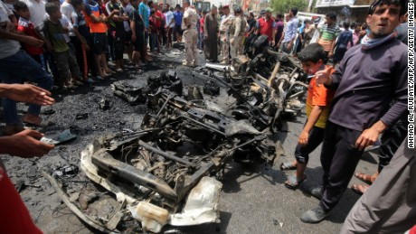 A crowd looks at the damage following a car bomb attack in Sadr City, a Shiite area north of the capital Baghdad.