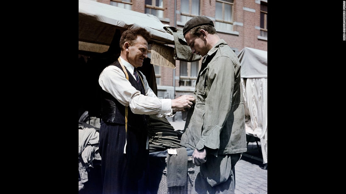 Discarded U.S. Army clothing is worn in Bastogne, Belgium, in 1947.