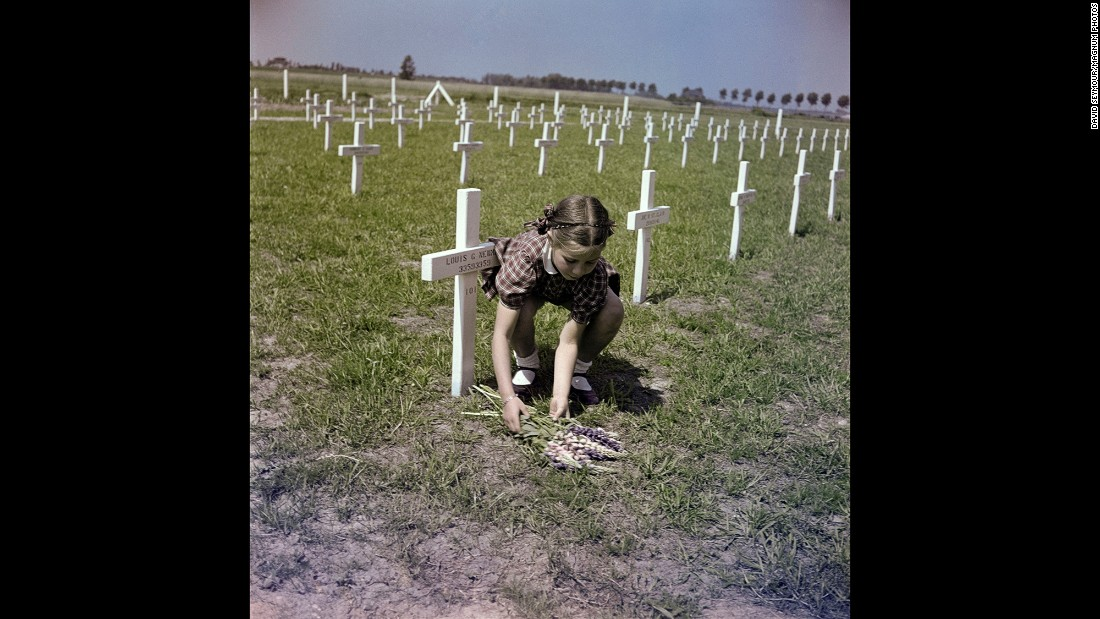 A girl lays flowers at a U.S. cemetery in Margraten, Netherlands, in 1947. It is now the Netherlands American Cemetery and Memorial.