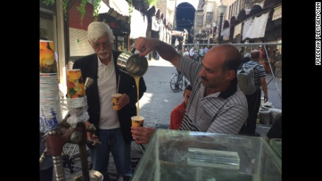 Thomas Webber paused to buy fresh-pressed orange juice from a street vendor in Damascus.
