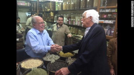 Thomas Webber greets the owner of a shop in Damascus that sells spices and herbal remedies. The same family has owned the shop for 200 years.