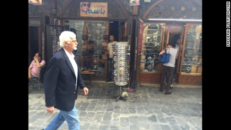 American Thomas Webber strides through the streets of Damascus, where he's lived 40 years.