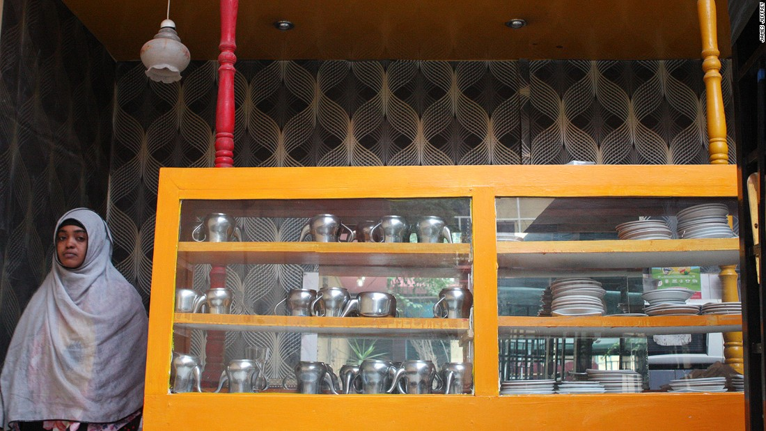 The Oriental's collection of stainless steel teapots is stacked in a cabinet in the courtyard bar. According to one guest, all of the teapots have long since lost the hinges that attach their lids.