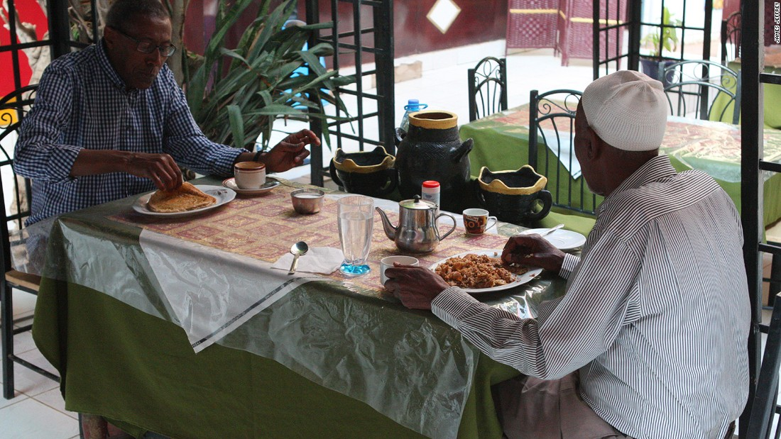 British Somalilanders visiting from the UK, Jirdeh Farar (left) and Mohamud Hassan (right), enjoy breakfast. Both are Oriental regulars, often staying for more than a month at a time at the hotel.