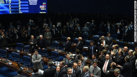 The final score of a Senate vote with an overwhelming 55-22 on suspending Brasilian President Dilma Rousseff and launching an impeachment trial is pictured on a large screen inside the Senate in Brasilia on May 12, 2016. Brazilian President Dilma Rousseff was suspended on May 12 to face impeachment, ceding power to her vice-president-turned-enemy Michel Temer in a political earthquake ending 13 years of leftist rule over Latin America's biggest nation. / AFP / EVARISTO SA        (Photo credit should read EVARISTO SA/AFP/Getty Images)