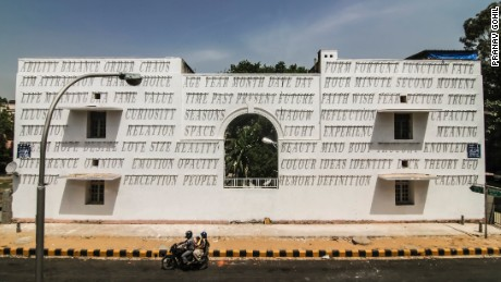 This light-sensitive mural, drilled into a New Delhi wall by Indian street artist 'Daku', is designed to change with the position of the sun.