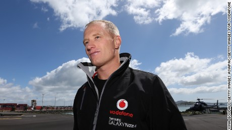 AUCKLAND, NEW ZEALAND - NOVEMBER 19:  America's Cup skipper Jimmy Spithill preapares to leave by helicopter from Mechanics Bays to race a Team Vodafone Sailing trimaran in Auckland's Hauraki Gulf on November 19, 2014 in Auckland, New Zealand.  The trimaran is being controlled by Samsung GALAXY Note 4 smartphone remotely by the skippers who are in a helicopter above the boats.  (Photo by Fiona Goodall/Getty Images for Vodafone)