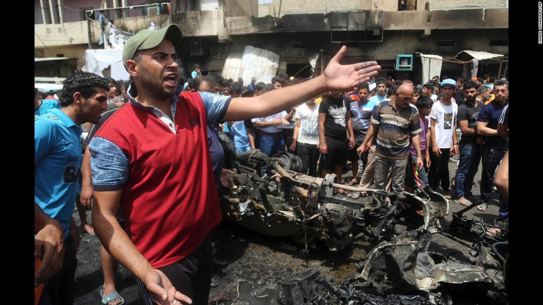 "People inspect the scene of a car bomb explosion at a crowded outdoor market in Baghdad, Iraq, on Wednesday, May 11. The militant group ISIS says it was behind <a href=""http://www.cnn.com/2016/05/11/middleeast/baghdad-market-bombing/index.html"" target=""_blank"">a series of attacks in the capital</a> that targeted Shiites and left more than 90 people dead."