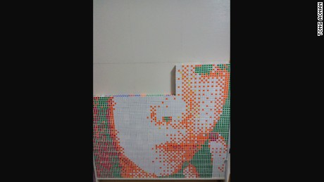 He came up with a design using Photoshop and ordered 840 Rubik's cubes online.