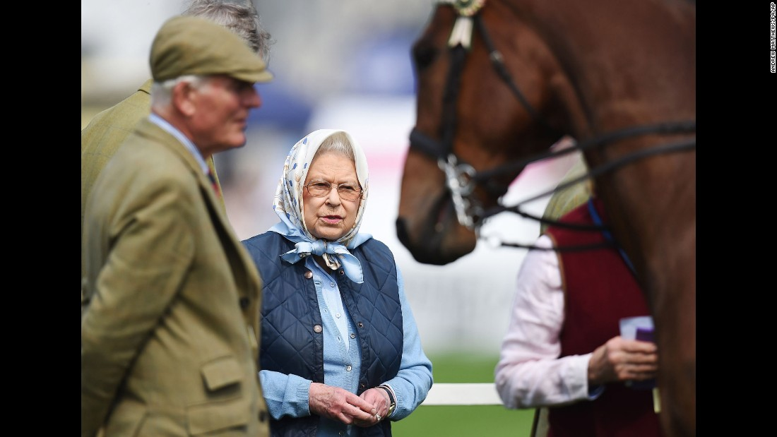 Britain's Queen Elizabeth II looks at a horse during the Royal Windsor Horse Show on Thursday, May 12.