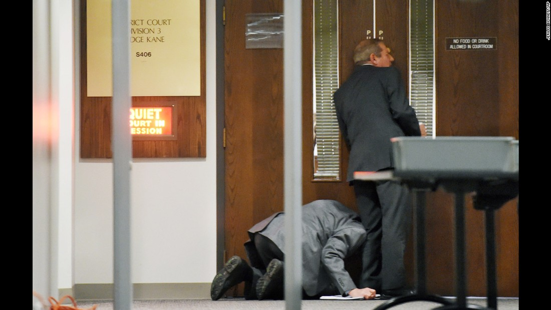 "Members of the media try to listen through the cracks of a door during a hearing for Robert Dear in Colorado Springs, Colorado, on Wednesday, May 11. A judge ruled that Dear, who is accused of killing three people at a Planned Parenthood clinic in November, <a href=""http://www.cnn.com/2016/05/11/us/planned-parenthood-shooting-robert-lewis-dear-hearing/"" target=""_blank"">is mentally incompetent to stand trial.</a>"
