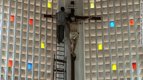 "A carpenter works on cleaning a crucifix in the capitol main Cathedral Notre Dame during preparation and rehearsal for the Pope visit on November 25, 2015 in Bangui, Central African Republic. Pope Francis said the world was facing a ""grave environmental crisis"" as he arrived in Kenya on Wednesday on a landmark Africa trip just days before a crucial UN summit aimed at curbing climate change. He also warned of the need to tackle poverty as a key driver of conflict and violence as he kicked off a landmark Africa trip fraught with security concerns and urged Kenya's leaders to work with ""transparency"" to ensure a fair distribution of national resources as criticism grows over runaway graft in this east African country. Pope Francis will visit Central African Republic on the 29 and 30 November.  / AFP / GIANLUIGI GUERCIA        (Photo credit should read GIANLUIGI GUERCIA/AFP/Getty Images)"