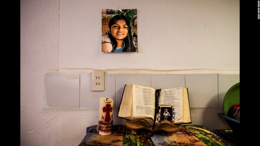 An altar is set in a home living room for Amanda, a 16-year-old who never came home from school in 2012. Every night, her father and sisters pray for her, said photographer Nuria Lopez Torres.