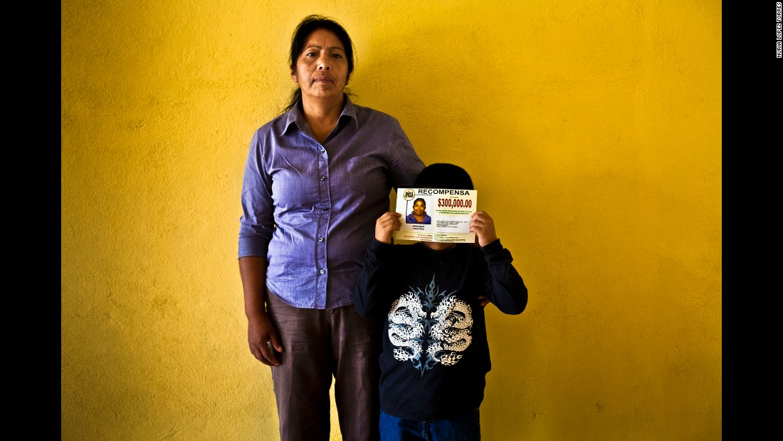 Tadeo, 7, holds a flyer next to his grandmother, Rosa Maria. Tadeo's mother, Fabiola, was kidnapped in 2012 when she left for a job interview.