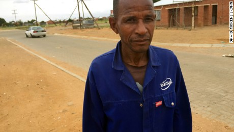 Joseph Mothibedi worked in gold mines for 30 years. Now he has silicosis and has trouble walking.