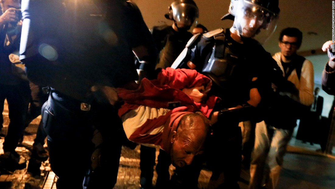 Riot police arrest a Rousseff supporter during a protest in Sao Paulo, Brazil on May 12.