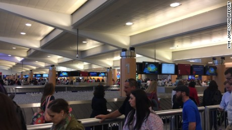 Kym Jones waited in line for two hours at Atlanta's Hartsfield-Jackson International Airport on Friday.