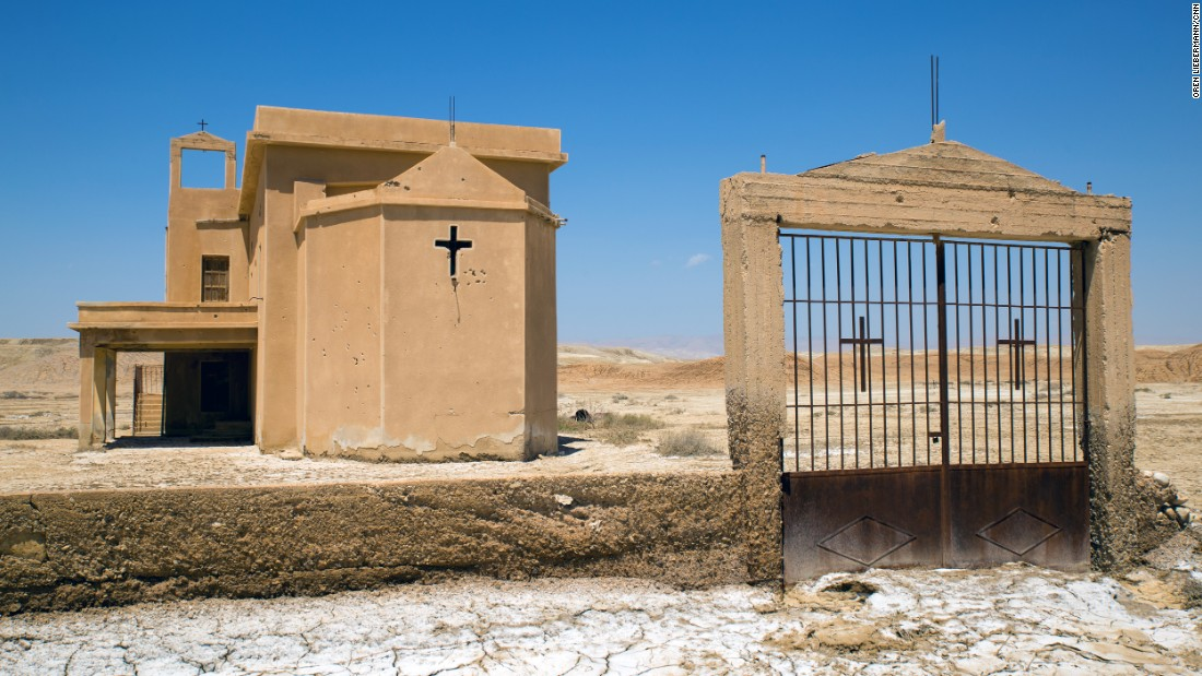 The Syrian Orthodox church, though deserted, remains in the best condition of the seven churches at the site. Bullet holes mark its facade, and mortar shells pepper the field surrounding it.