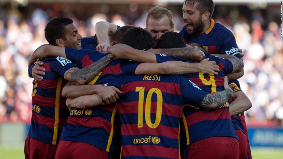 Barcelona's players celebrate a 24th La Liga title after a 3-0 win at Granada.
