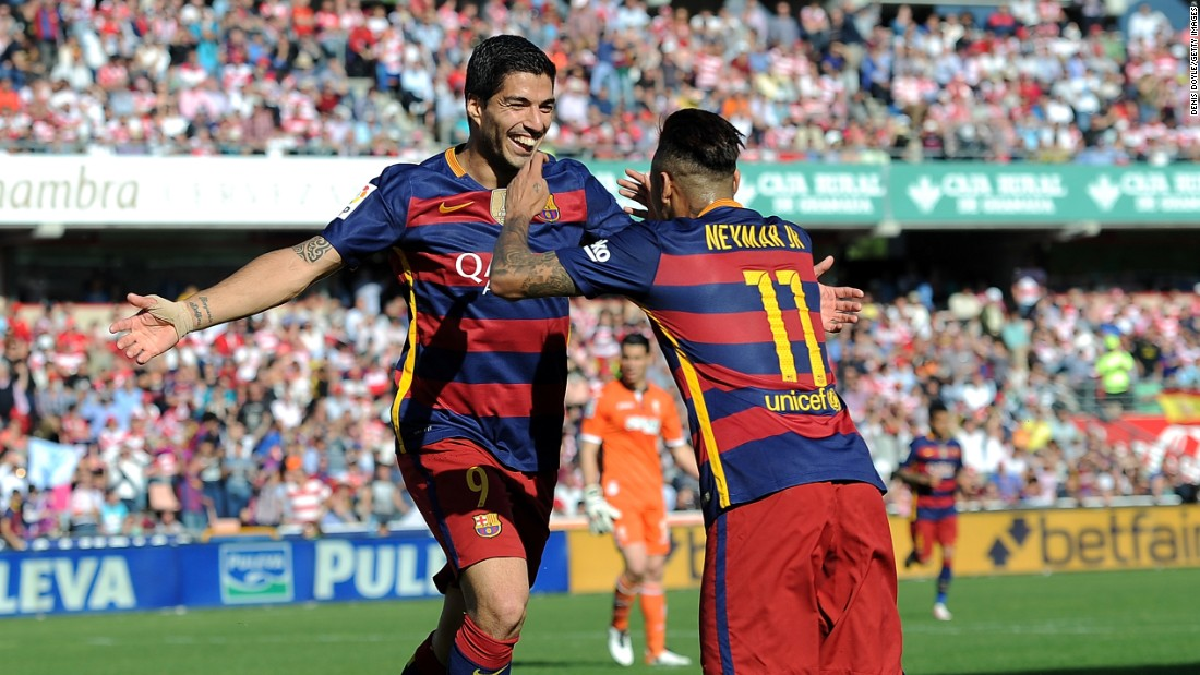 Suarez embraces Neymar after completing his hat-trick at Granada and his 40th league goal of the season.